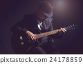 Musician playing the guitar on black background,music concept 24178859