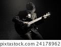 Musician playing the guitar on black background,music concept 24178962