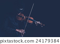 Violin player in dark studio, Musical concept 24179384