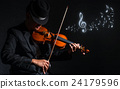 Violin player in dark studio with music notes, Musical concept 24179596