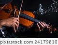 Close up Violin player in dark studio with music notes, Musical concept 24179810