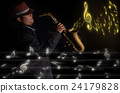 A saxophone player in a dark background with music melody, musical concept 24179828