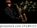 A saxophone player in a dark background with music melody, musical concept 24180152