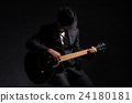 Musician playing the guitar on black background,music concept 24180181
