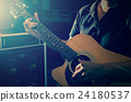 Closeup musician playing the guitar on band background with spot light, musical concept 24180537