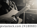 Closeup musician playing the guitar on band background with spot light, musical concept 24180683