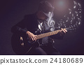 Musician playing the guitar with music notes on black background,music concept 24180689