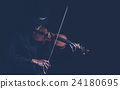 Violin player in dark studio, Musical concept 24180695