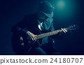 Musician playing the guitar on black background,music concept 24180707