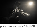 Musician playing the Trumpet with spot light on the stage 24180708