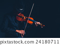 Violin player in dark studio, Musical concept 24180711