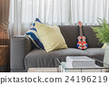 set of pillows on modern grey sofa in living room  24196219