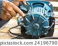 Electric motor and man working equipment repair 24196790