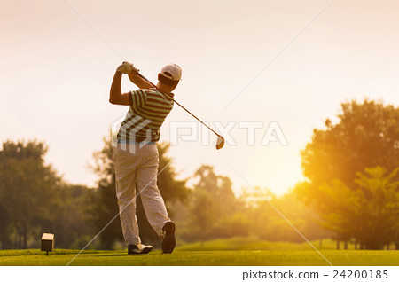 Golfers hit sweeping golf course in the summer 24200185