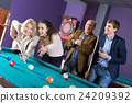 Positive middle class people having pool game 24209392