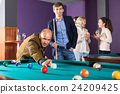Smiling people having pool game 24209425