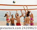 adults throwing ball over net and laughing 24209623