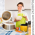Housewife cooking rice with multicooker 24209756