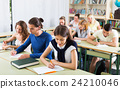 Young student listening attentively 24210046