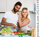 Interracial couple preparing healthy dinner. 24210149