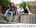 Teenagers with smarthphones 24210834