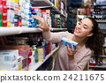 Female customer buying toothpaste 24211675