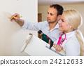 Family makes repairs at home 24212633