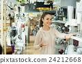 Adult woman selecting lighting units 24212668