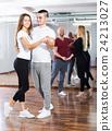 Couples enjoying of partner dance 24213027