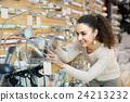 Woman choosing interior lights in mall. 24213232