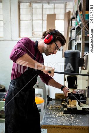 Stock Photo: Carpenter working on his craft