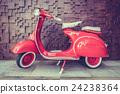Red vintage motorcycle 24238364