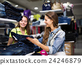 Woman buying pants in store 24246879