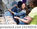 woman, choosing, jeans 24246936