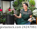 Florist working in floral shop 24247061