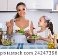 Family of two having healthy lunch with veggies 24247396