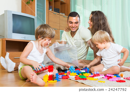 Happy family playing in home interior 24247792