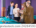 Adults with wine at billiard table. 24264593