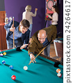 Group of adults playing pool. 24264617