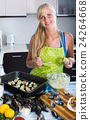 woman preparing tigres espanol with mussels indoors 24264668