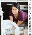 Young woman near washing machine 24264691