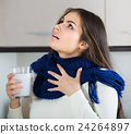 Girl with throat pain gargling throat in kitchen 24264897