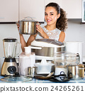 Positive girl with culinary devices posing 24265261