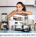 Housewife with multicooker and appliances 24265263
