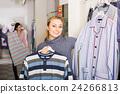 Girl shopping sleepwear for man 24266813