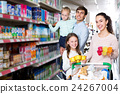Parents with two kids buying fruit yoghurt 24267004