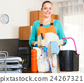 Woman cleaning office room. 24267321