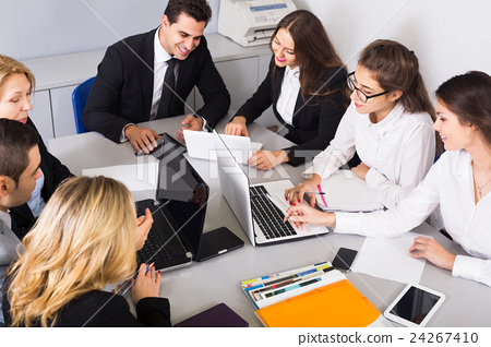Chief with professional officials discussing preparing contract 24267410