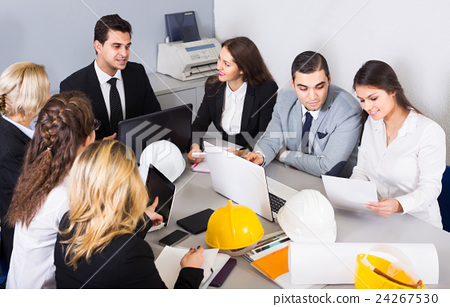 company of architects brainstorming in office 24267530