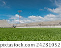 green filed gress of sport stadium with blue sky 24281052